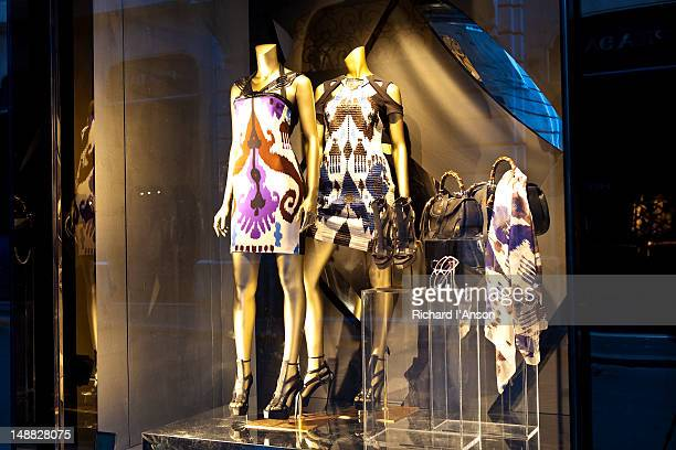 gucci shop window on via dei condotti. - gucci dress stock pictures, royalty-free photos & images