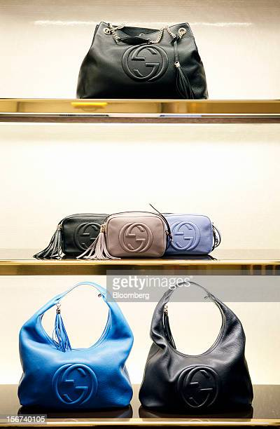 Gucci 'Soho' ladies handbags bearing the interlocking 'G' logo sit displayed for sale inside a Gucci store a luxury unit of France's PPR SA in Rome...