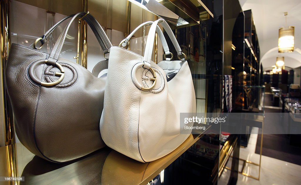 Gucci 'Twill' bags bearing the interlocking 'G' logo sit displayed for sale inside a Gucci store, a luxury unit of France's PPR SA, in Rome, Italy, on Monday, Nov. 19, 2012. PPR SA, the French owner of the Gucci and Puma brands, said it's confident of revenue and profit growth in 2012. Photographer: Alessia Pierdomenico/Bloomberg via Getty Images