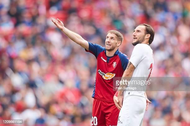 Gudej of Sevilla FC argue with Brasanac of CA Osasuna during the Liga match between Sevilla FC and CA Osasuna at Estadio Ramon Sanchez Pizjuan on...