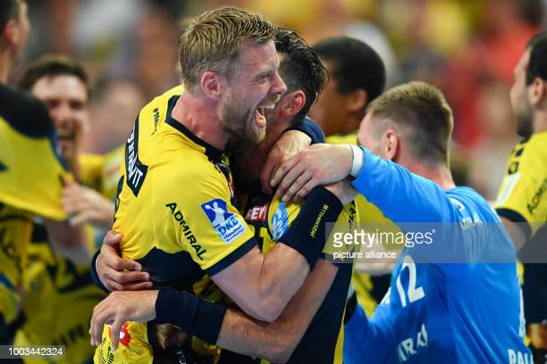 Gudjon Valur Sigurdsson Alexander Petersson and goalie Andreas Palicka of the RheinNeckar Loewen celebrate winning the championships at the...