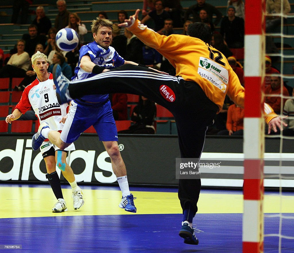 Gudjon Valur Sigurdsson of Iceland in action with Nandor Fazekas of Hungary during the Men's Handball European Championship main round Group II match between Hungary and Iceland at Trondheim Spektrum on January 23, 2008 in Trondheim, Norway.