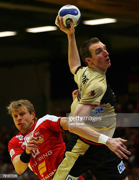 Gudjon Valur Sigurdsson of Iceland is seen in action with Holger Glandorf of Germany during the Men's Handball European Championship main round Group...