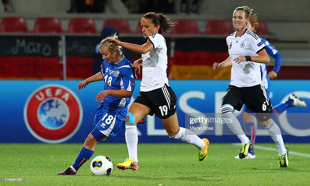Gudny Odinsdottir (L) of Iceland and Fatmire Bajramaj (R) of Germany battle for the ball during the UEFA Women's Euro 2013 group B match between Iceland and Germany at Vaxjo Arena on July 14, 2013 in Vaxjo, Sweden.