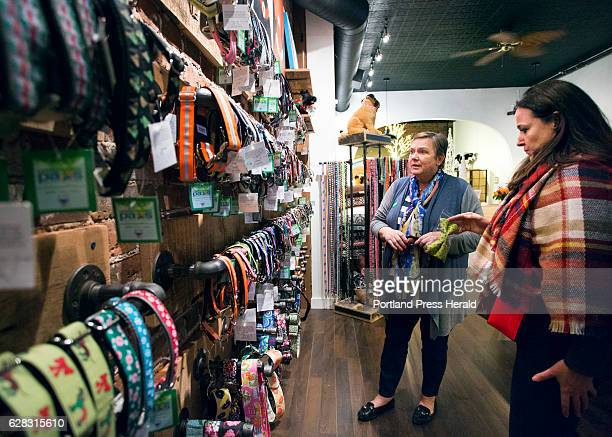 Gudrun Cobb helps Teresa Drisko right of Quincy MA find a collar for her pet at Uncommon Paws in the Old Portland on Saturday Nov 26 2016 Cobb makes...