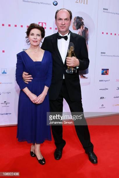Gudrun Landgrebe and award winner Herbert Knaup attend the Diva Award 2011 at Hotel Bayerischer Hof on January 25 2011 in Munich Germany