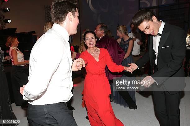 Gudrun Landgrebe dance with David Brauner and Ben Brauner during the 70th anniversary of Arthur Brauner's CCC Film Studios on September 23 2016 in...