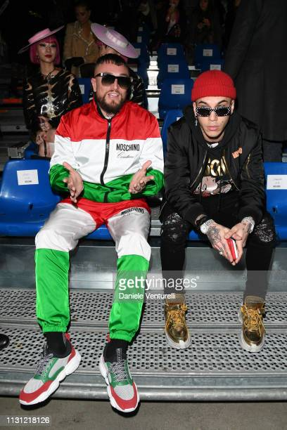 Gue Pequeno and Sfera Ebbasta attend the Moschino show at Milan Fashion Week Autumn/Winter 2019/20 on February 21 2019 in Milan Italy
