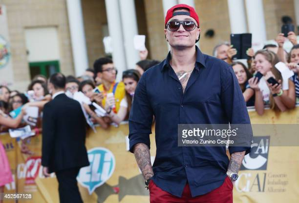 Gue Pequeno attends Giffoni Film Festival blue carpet on July 23 2014 in Giffoni Valle Piana Italy