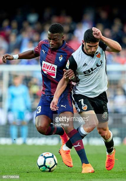 Guedes of Valencia CF competes for the ball with Pape Diop of SD Eibar during the La Liga game between Valencia CF and SD Eibar at Mestalla on April...