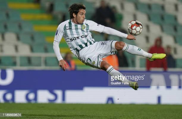 Guedes of Vitoria FC scores a goal with bicycle kick during the Allianz Cup match between Vitoria FC and SL Benfica at Estadio do Bonfim on December...