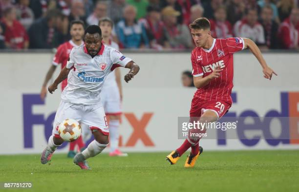 Guelor Kanga of Belgrad and Salih Oezcan of Koeln battle for the ball during the UEFA Europa League group H match between 1 FC Koeln and Crvena...
