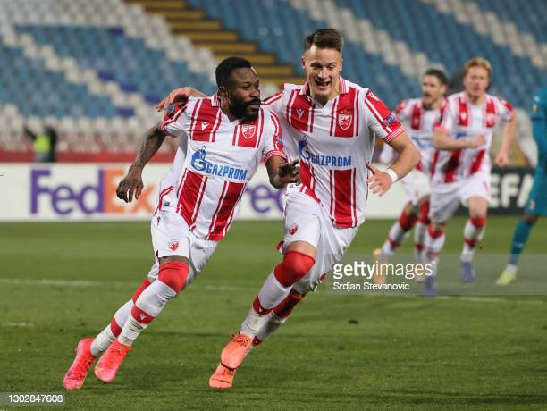 Guelor Kanga of Crvena Zvezda celebrates after scoring their sides first goal from the penalty spot with team mate Njegos Petrovic during the UEFA...