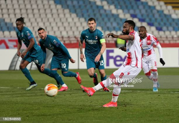 Guelor Kanga of Crvena Zvezda scores their sides first goal from the penalty spot during the UEFA Europa League Round of 32 match between Crvena...