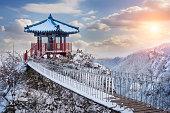 A guemosan snowy bridge at dawn