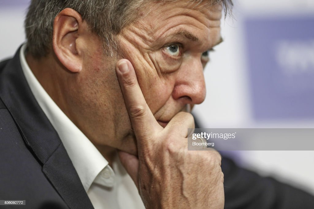 Guenter Butschek, chief executive officer of Tata Motors Ltd., listens during a news conference in Mumbai, India, on Monday, Aug 21, 2017. Tata Motors has made an investment commitment of 25 billion rupees for future passenger vehicle programs, Butscheksaid. Photographer: Dhiraj Singh/Bloomberg via Getty Images