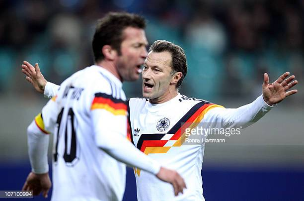 Guenter Hermann and Lothar Matthaeus of the World Champion 1990 during the Reunification match between the World Champion 1990 and the DFV Legend at...