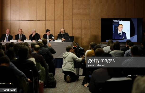 Guenter Lubitz father of the Germanwings copilot of the plane crash in the Alps participates in a press conference while a photo of his son Andreas...