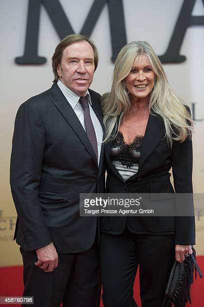 Guenter Netzer and Elvira LangNetzer attend the 'Die Mannschaft' premiere at Potsdamer Platz on November 10 2014 in Berlin Germany