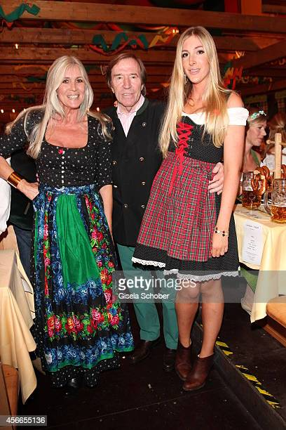 Guenter Netzer and his wife Elvira and his daughter Alana during Oktoberfest at Schuetzenzelt/Theresienwiese on October 4 2014 in Munich Germany