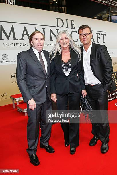 Guenter Netzer Elvira Lang Netzer and Torsten Koch attend the 'Die Mannschaft' Premiere at Sony Centre on November 10 2014 in Berlin Germany