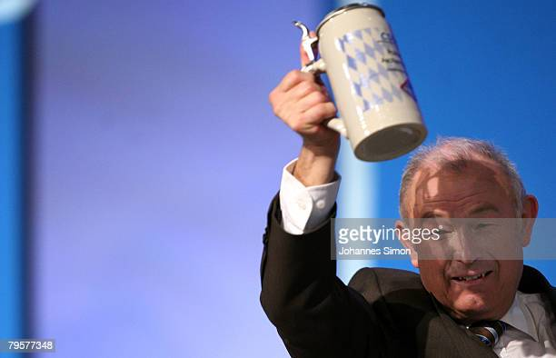 Guenther Beckstein Bavarian State Governor lifts a beer mug after delivering a speech during the traditional Christian Social Union Ash Wednesday...