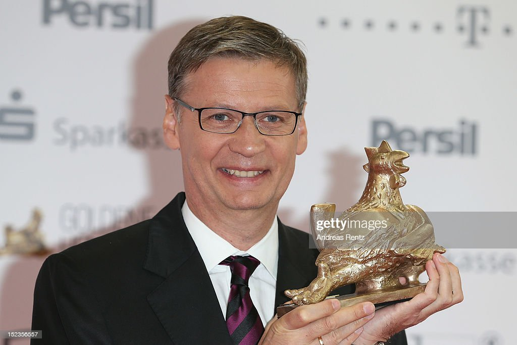 Guenther Jauch holds up his award at 'Goldene Henne' 2012 award on September 19, 2012 in Berlin, Germany.