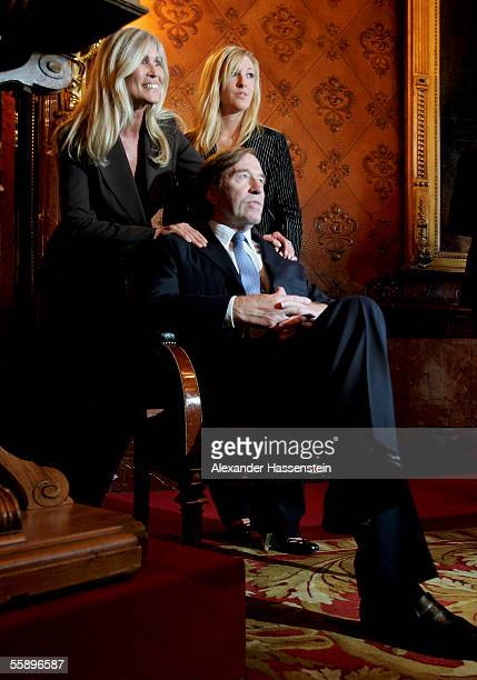 Guenther Netzer poses with his wife Elvira Netzer and daughter Alana Netzer during the reception of the Senate of Hamburg at City Hall October 11...