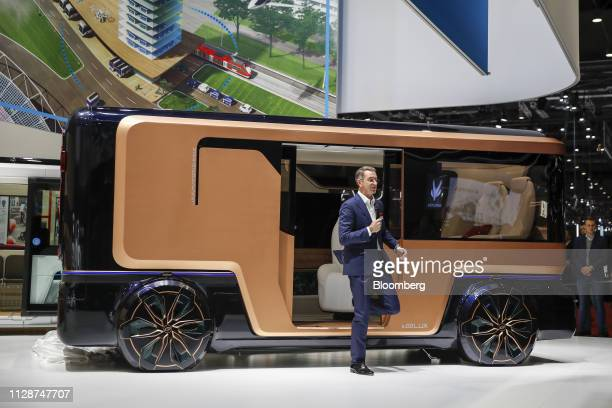 Guenther Schuh founder of eGO Mobile AG steps out of the eGO Lux electric bus vehicle on the opening day of the 89th Geneva International Motor Show...