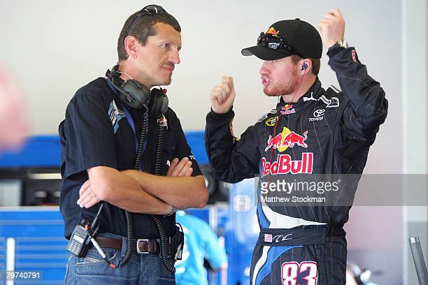 Guenther Steiner the technical director for Red Bull Racing Team talks with Brian Vickers driver of the Red Bull Toyota in the garage during practice...