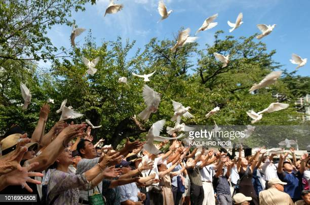 People release doves to honour the dead at the Yasukuni shrine on the 73rd anniversary of Japan's surrender in World War II in Tokyo on August 15...
