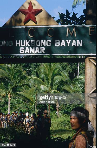 Guerilla fighters at the NPA secret base camp gate in the jungle   Location Bagdan Bayan Philippines