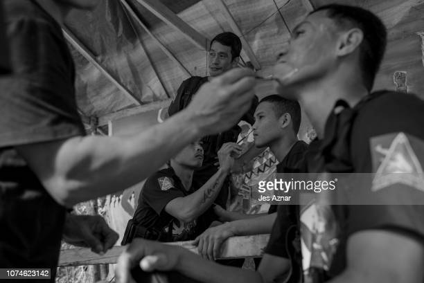 NPA guerilla fighters prepare for a program and presentation inside a stronghold on December 13 2018 in a remote village in the Bicol region...