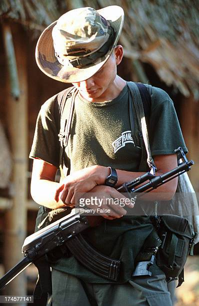 A guerilla in charge of the security of the Free Burma Rangers team prays before departing on a mission With the help of foreign volunteers teams of...