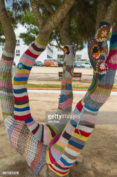 Guerilla Knitting' street art Some trees in a public park in the Portuguese town of Sagres were decorated with colorful knitted arrangements
