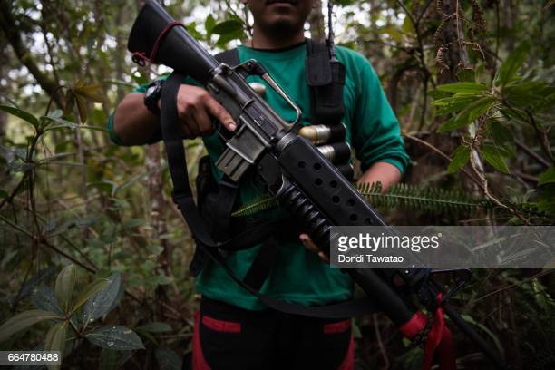 A guerillas of the New People's Army display his firearm on April 1 2017 in the remote hinterlands of Mountain Province Philippines The NPA which is...