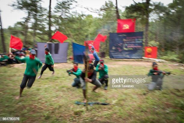 Guerillas of the New People's Army perform a flag dance during a simple program celebrating the 48th year anniversary of the NPA in the remote...