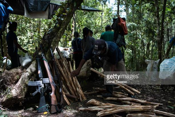 Guerillas of the New People's Army prepare meals at a makeshift kitchen of the camp on April 1 2017 in the remote hinterlands of Mountain Province...