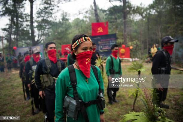 Guerillas of the New People's Army stand in formation on April 2 2017 in the remote hinterlands of Mountain Province Philippines The NPA which is the...