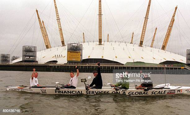 Guernsey oarsmen on the River Thames make their way past the Millennium Dome in Greenwich London LR John Catwyk John Lewis Mark Sheppard Andrew...