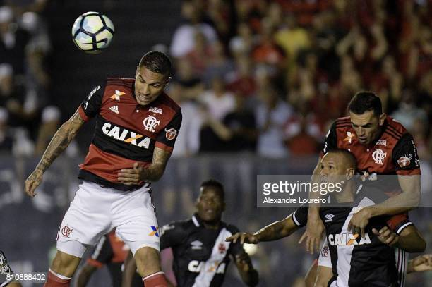 Guerrero and Rhodolfo of Flamengo battles for the ball with Luis Fabiano of Vasco da Gama during the match between Vasco da Gama and Flamengo as part...
