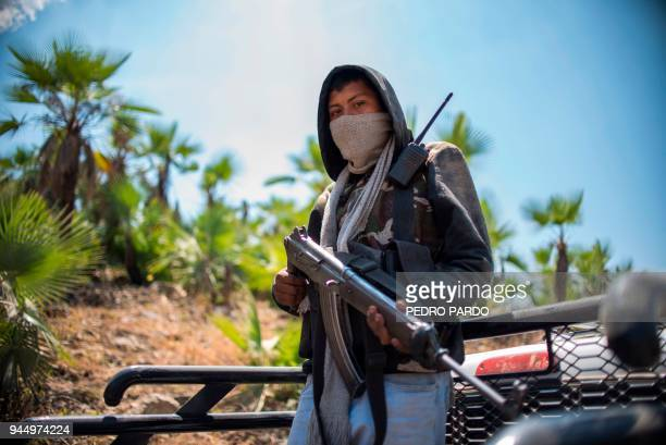 Guerrero Community Police member stands guard in the hills of Carrizalillo, Guerrero state, Mexico, on March 24, 2018. In the mountainous area of...
