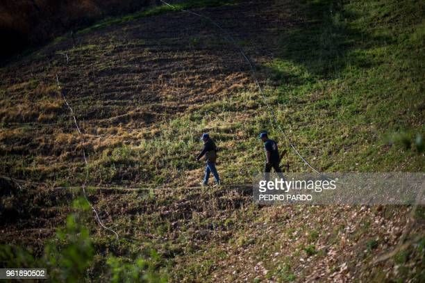 Guerrero Community Police members patrol at an illegal poppy field, in Heliodoro Castillo, Guerrero state, Mexico, on March 25, 2018. - In the...