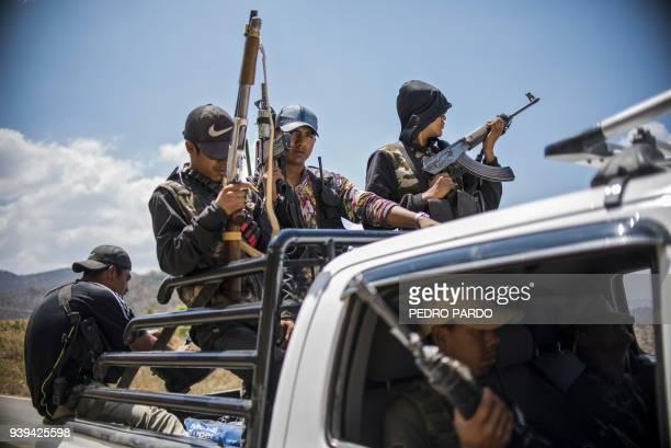 Guerrero Community Police members patrol the hills in Carrizalillo, Guerrero state, Mexico, on March 24, 2018. In the mountains of Guerrero, despite...