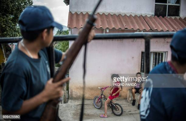 TOPSHOT Guerrero Community Police members stand guard in Tlacotepec Heliodoro Castillo municipality Guerrero state Mexico on March 24 2018 In the...