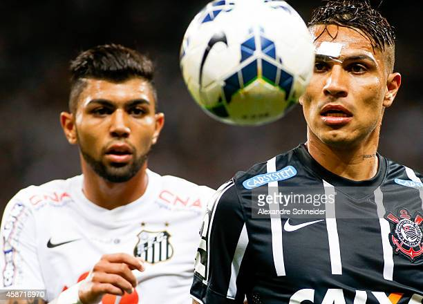 Guerrero of Corinthians and Gabriel of Santos in action during the match between Corinthians and Santos for the Brazilian Series A 2014 at Arena...