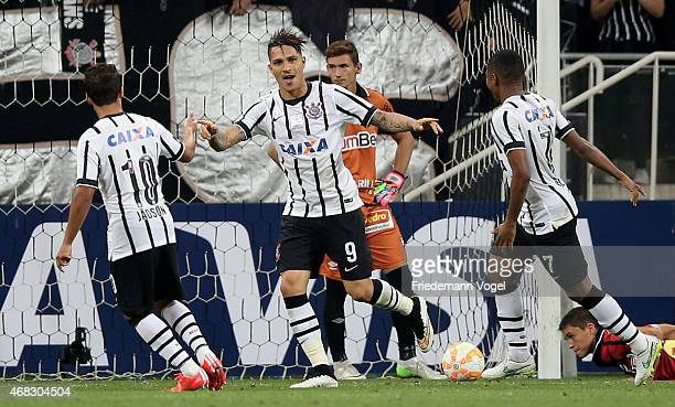 Guerrero of Corinthians celebrates scoring the third goal with Elias and Jadson during a match between Corinthians and Danubio as part of Group 2 of...