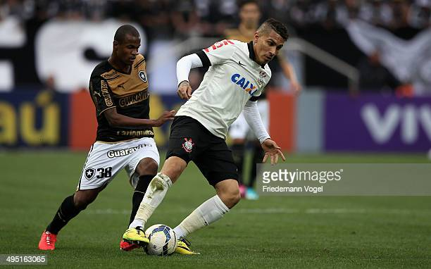 Guerrero of Corinthians fights for the ball with Airton of Botafogo during the match between Corinthians and Botafogo for the Brazilian Series A 2014...