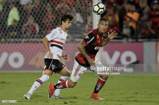 Guerrero of Flamengo battles for the ball with Rodrigo Caio of Sao Paulo during the match between Flamengo and Sao Paulo as part of Brasileirao...