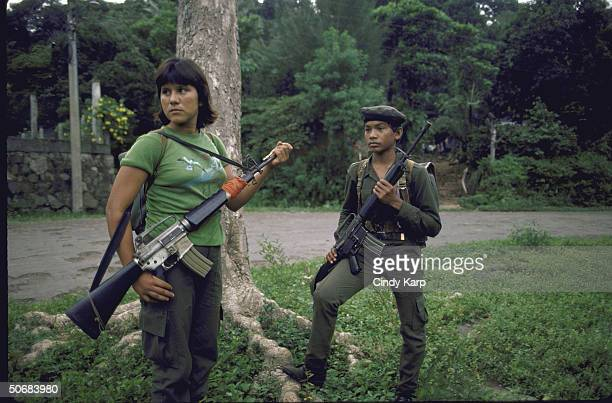FMLN guerrilla boy and girl armed with rifles